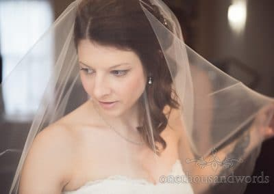 Bride through veil on morning of Scaplens Court wedding photographs