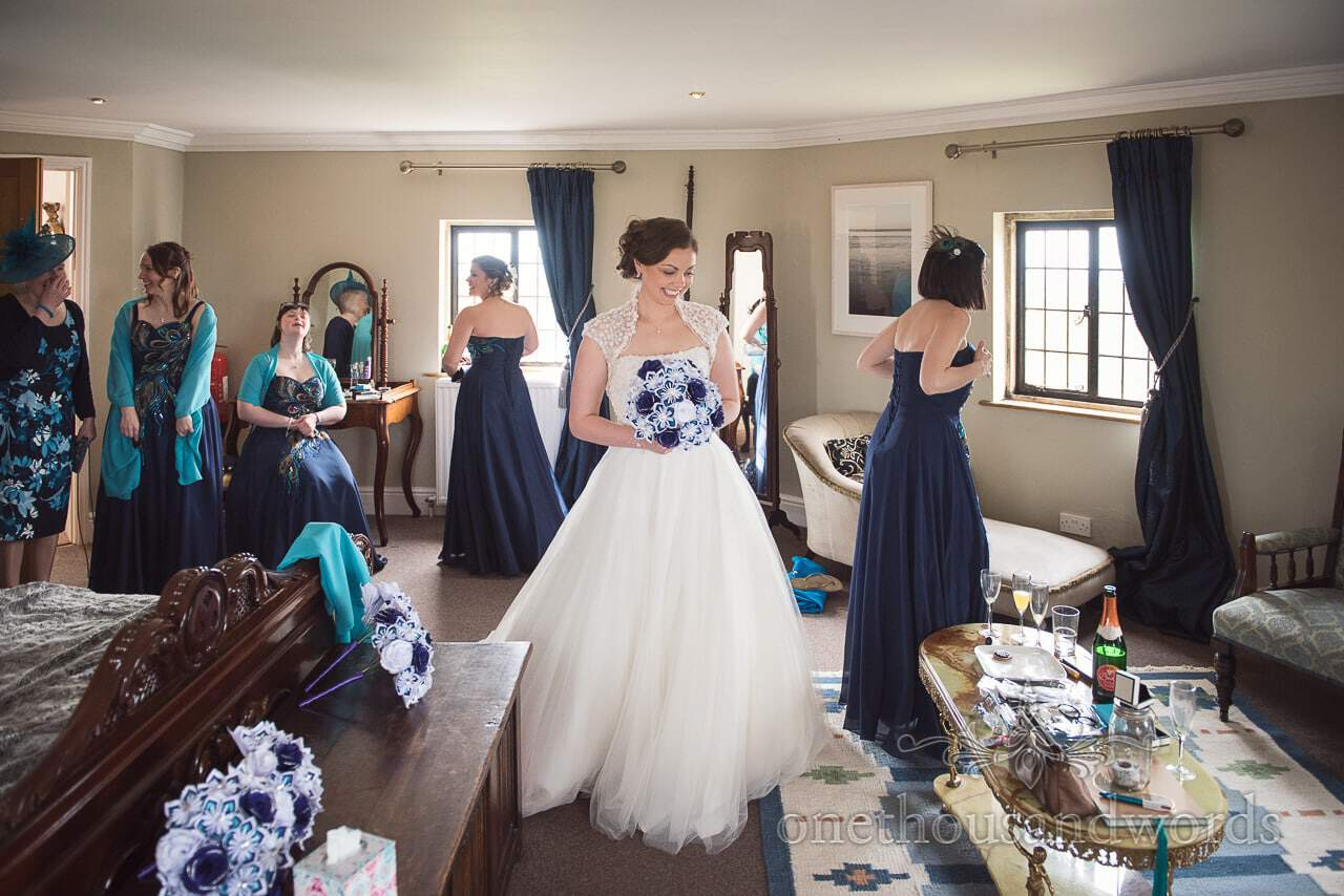 Bride with all bridesmaids and mother of the groom on morning of Walton Castle wedding photographs