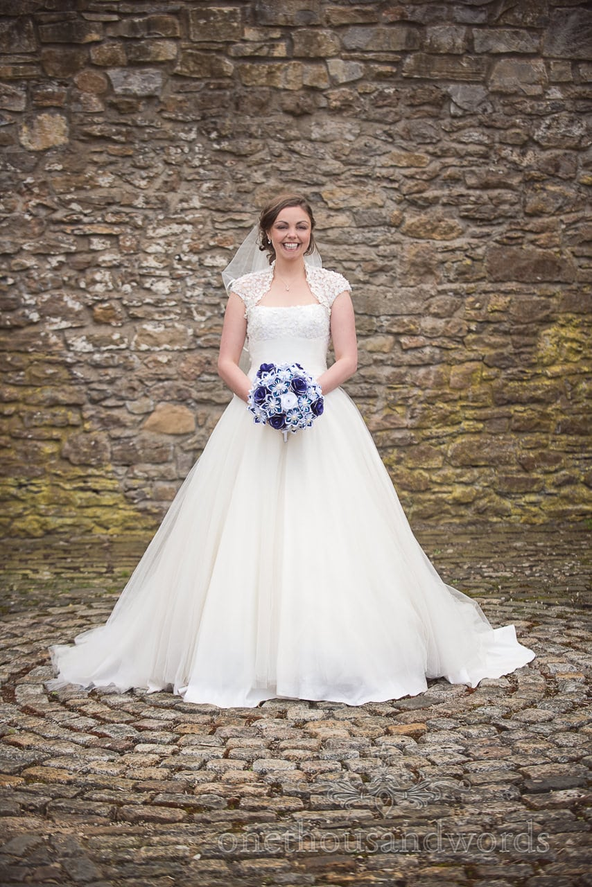Bride with paper flowers and button bouquet at Walton Castle wedding photographs