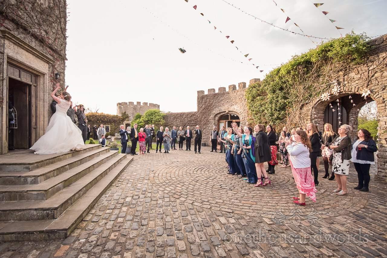 Brides bouquet is thrown at Walton Castle wedding photographs
