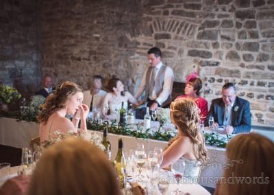Bridesmaid dries her eyes during speech at Scaplens court wedding photographs