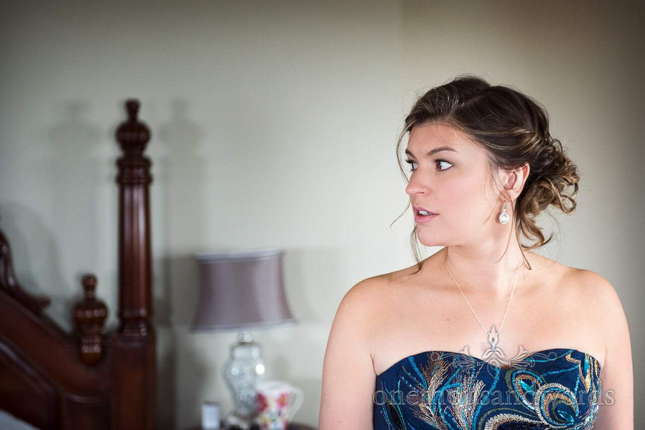 Bridesmaid in peacock detailed dress at Walton Castle wedding photographs
