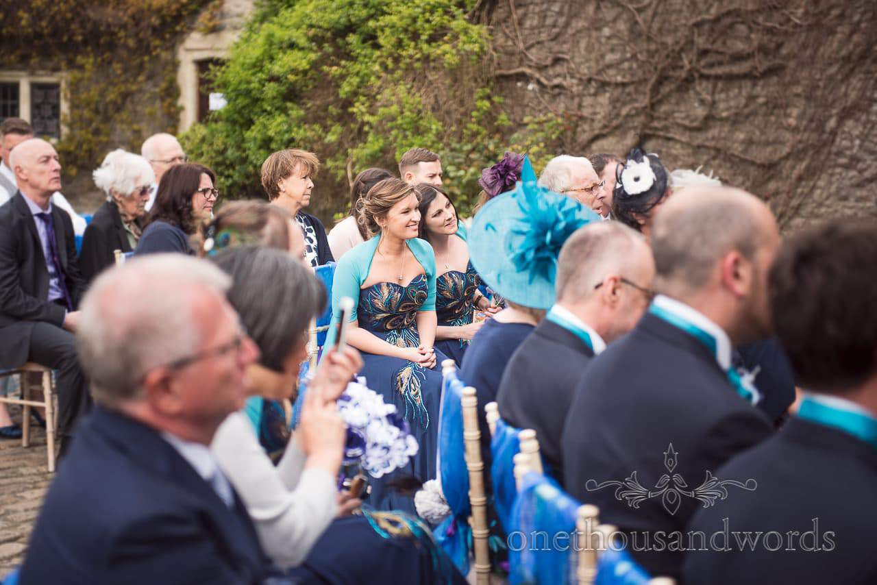 Bridesmaids during ceremony at Walton Castle wedding photographs