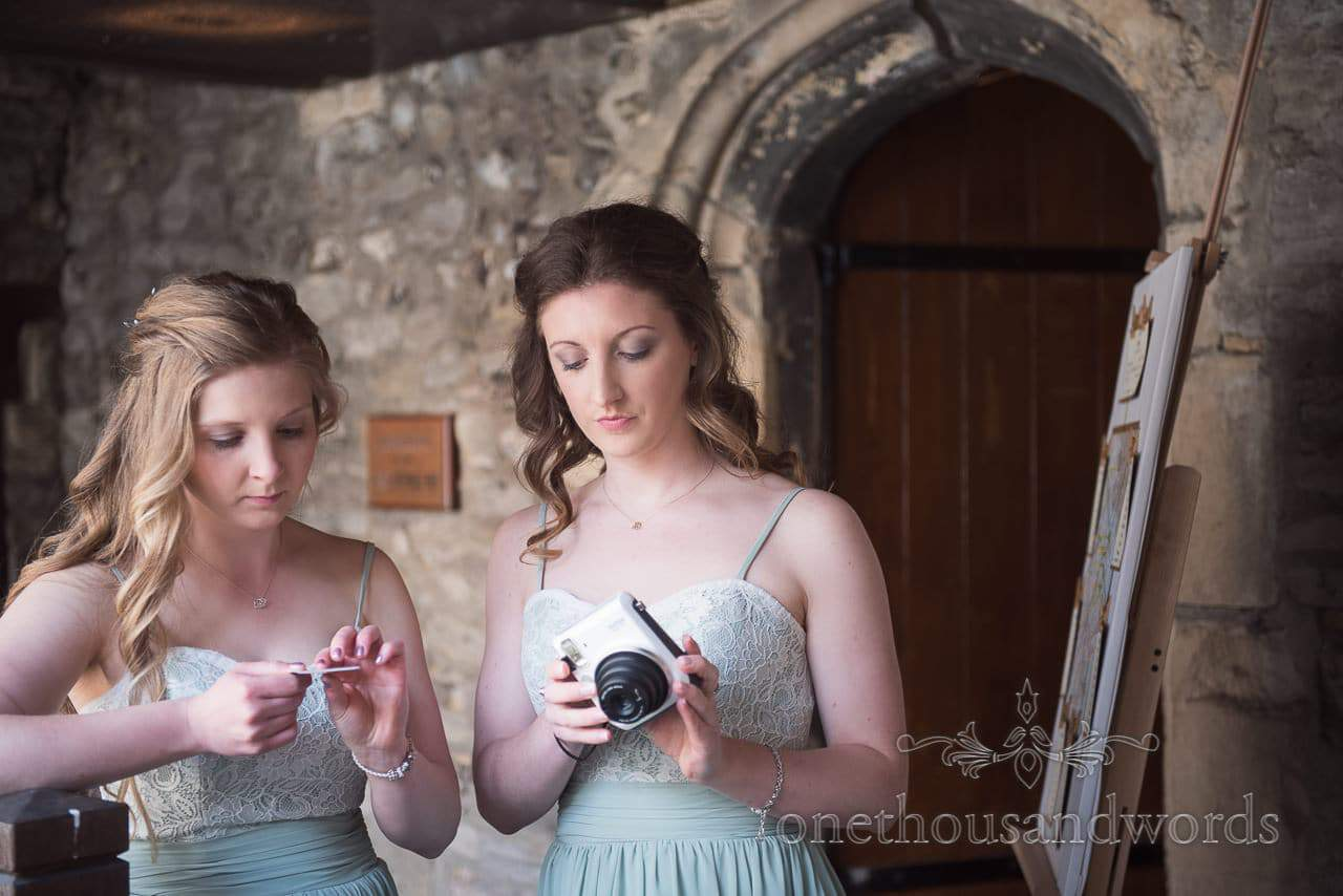 Bridesmaids with Polaroid camera at Scaplens Court wedding photographs