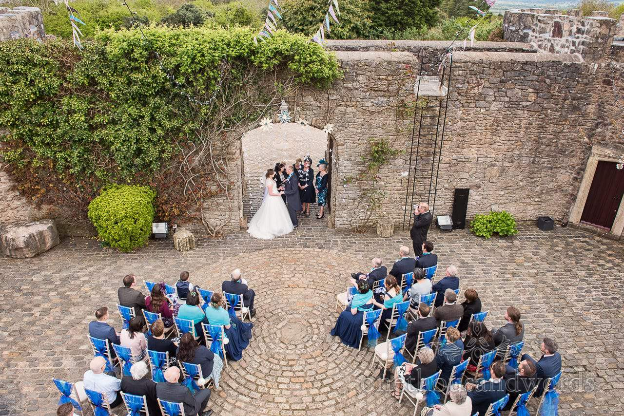 Ceremony from window at Walton Castle wedding photographs
