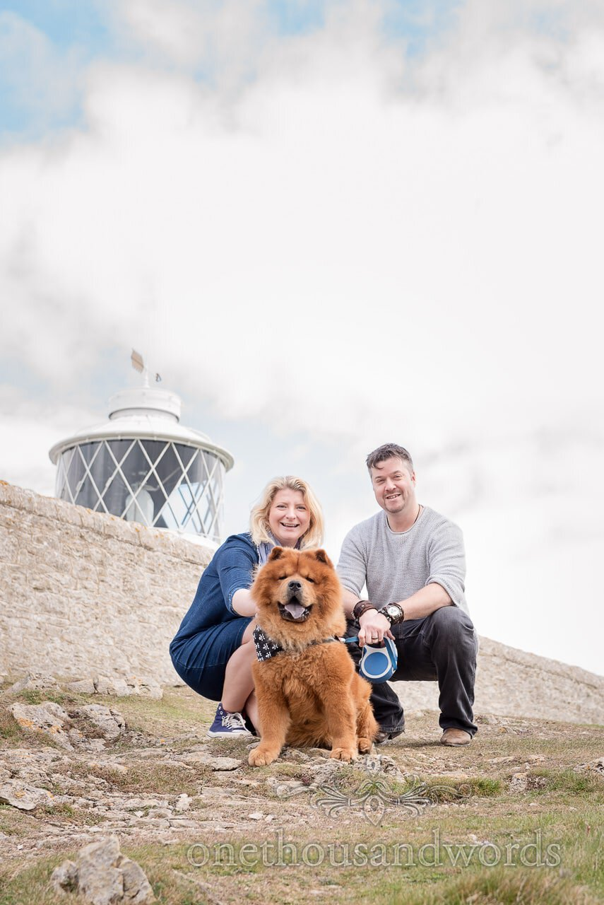 Chow Chow dog and bride and groom at Durlston Country Park Engagement Photos with lighthouse in background