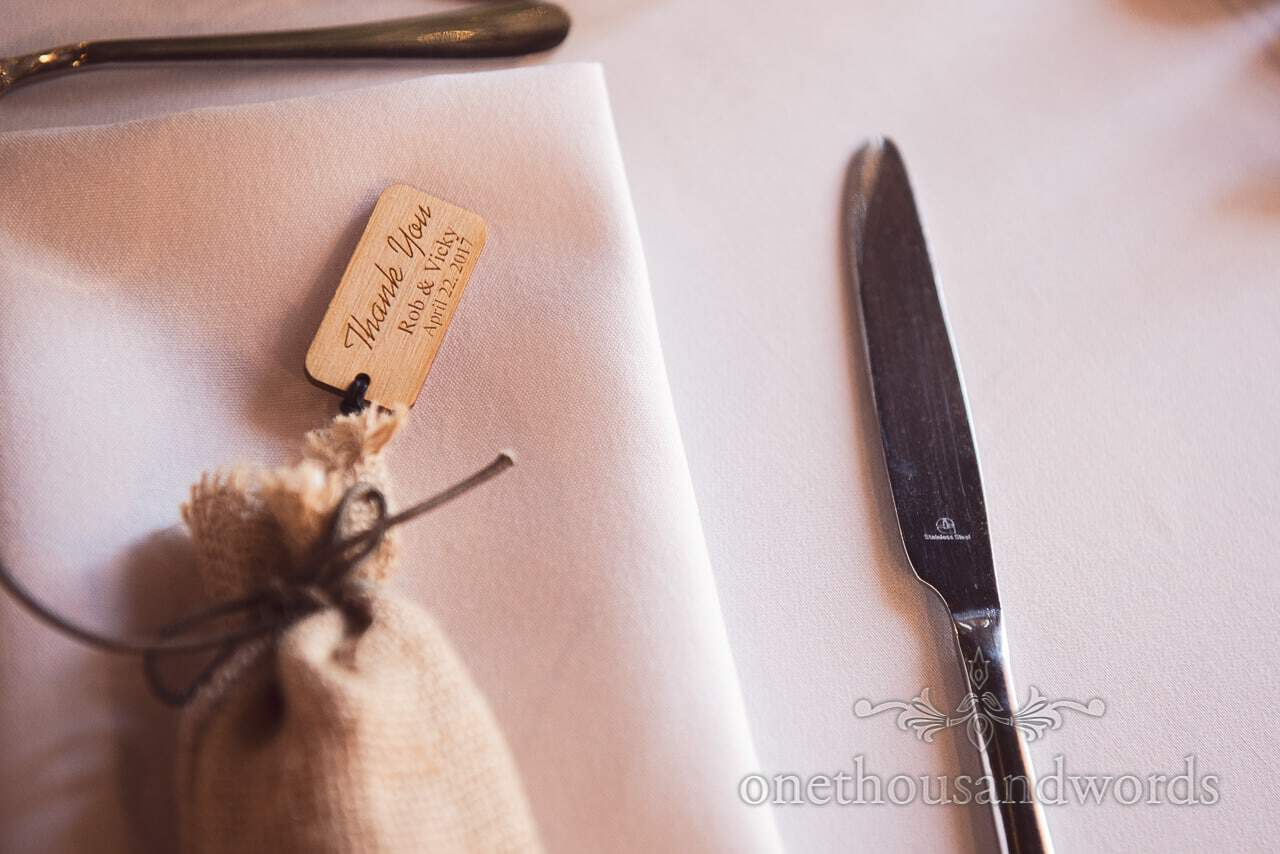 Custom tags on wedding favor bags at Scaplens court wedding photographs