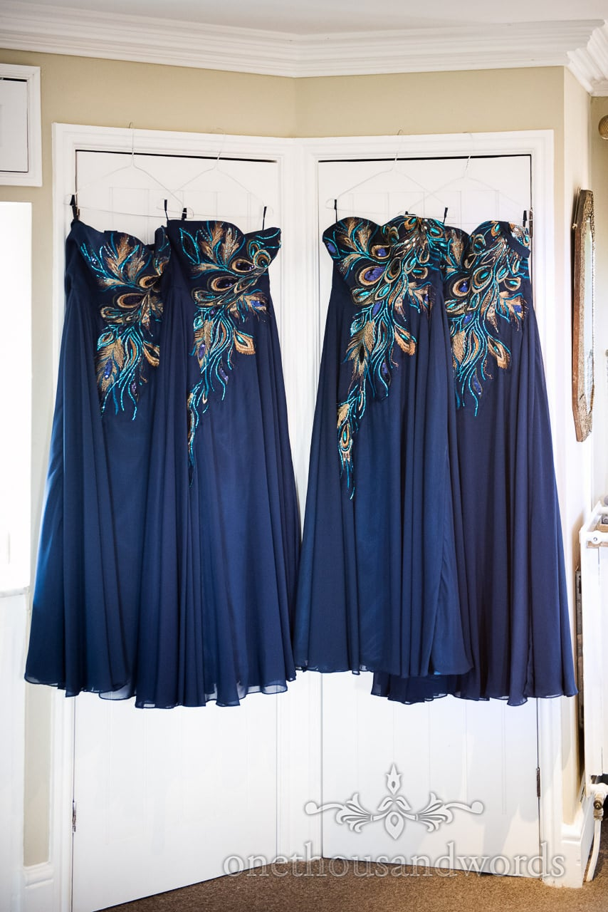 Dark Blue Bridesmaids Dresses with peacock detail from Walton Castle Wedding Photographs