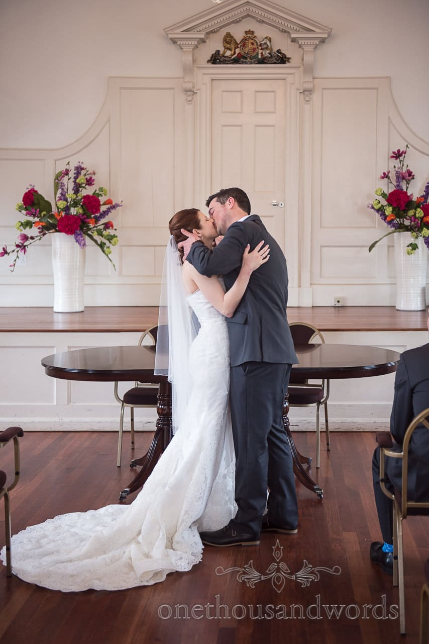 First kiss at Guildhall ceremony from Scaplens Court wedding photographs