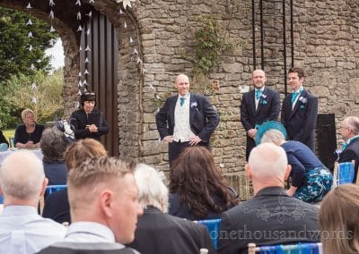 Groom and groomsmen await brides arrival at Walton Castle wedding photographs