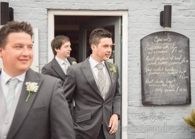 Groom and groomsmen before Scaplens Court wedding photographs