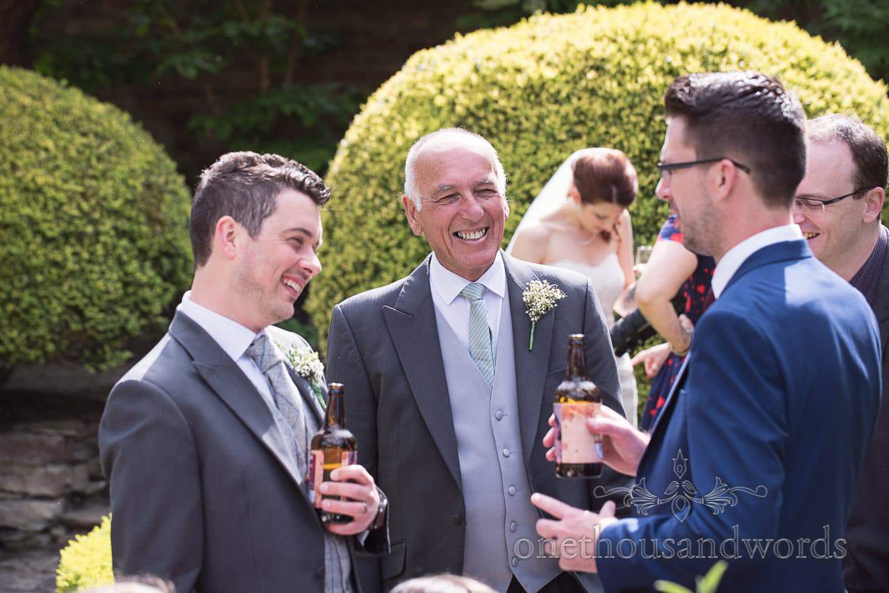 Groom and guests in the walled garden at Scaplens Court wedding photographs