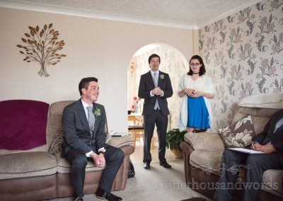Groom at parents home before Scaplens Court wedding photographs