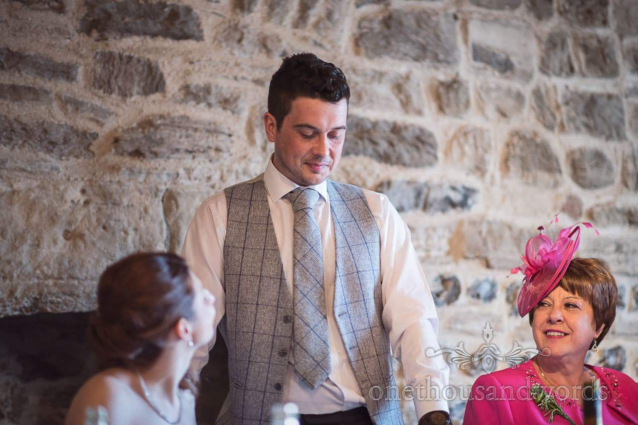Groom delivers speech as mother looks on at Scaplens court wedding photographs