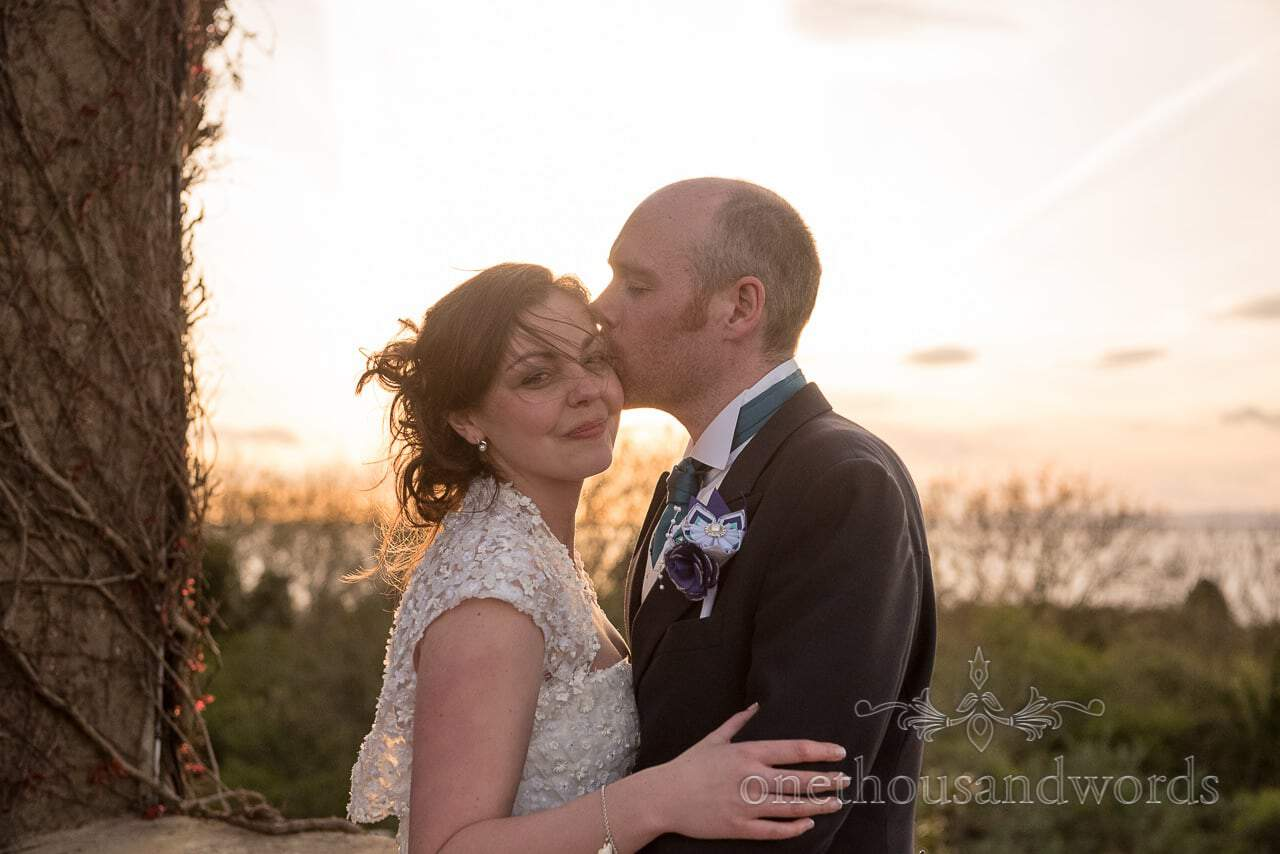 Groom kisses Bride at Walton Castle wedding photographs