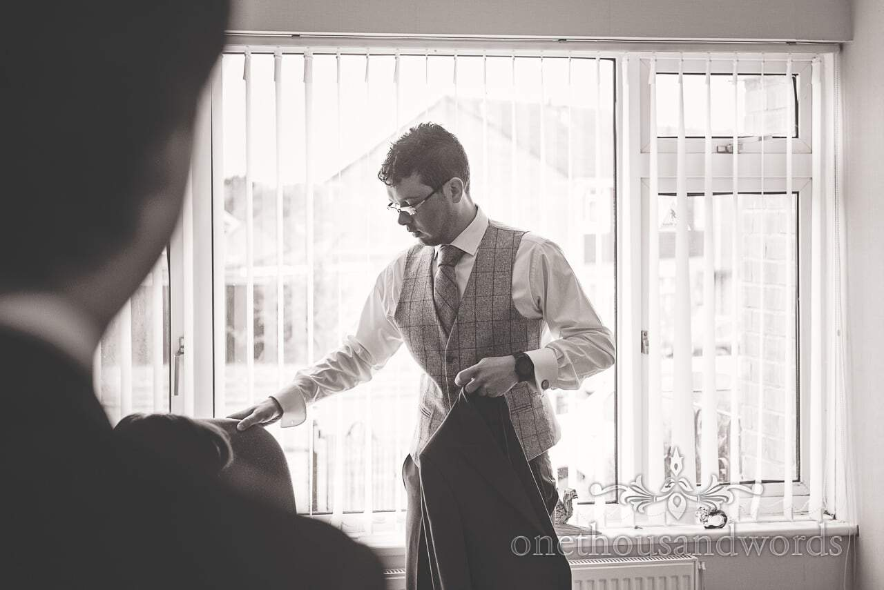Groom on morning of Scaplens Court wedding photographs