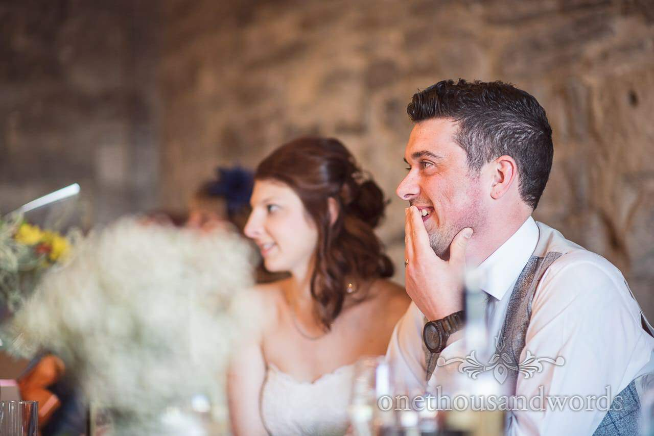 Groom reaction from Scaplens court wedding photographs