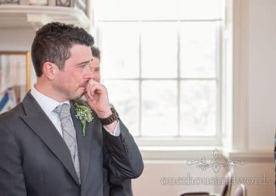Groom sees his bride at Poole guildhall wedding photographs