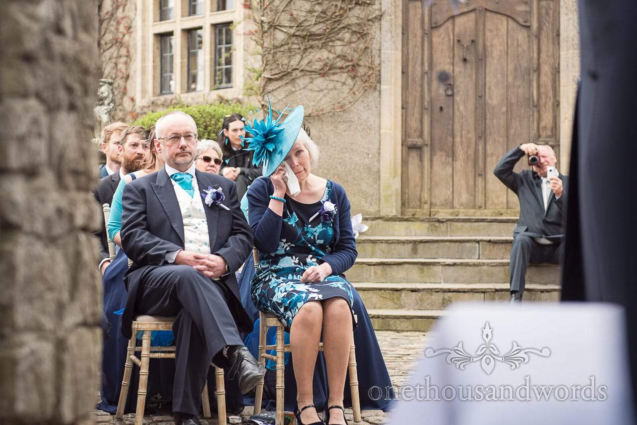 Grooms parents during ceremony at Walton Castle wedding photographs