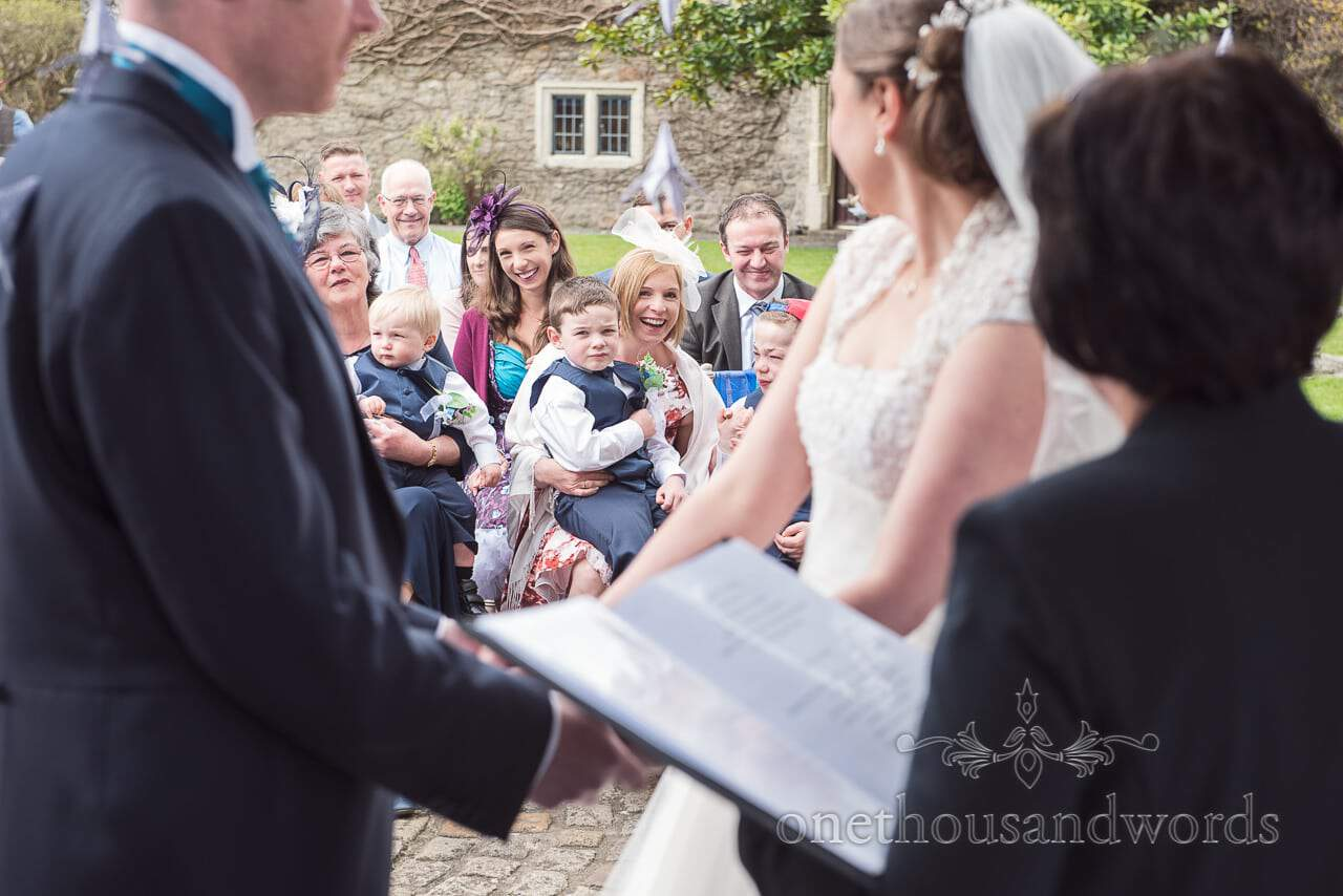Guests during ceremony at Walton Castle wedding photographs