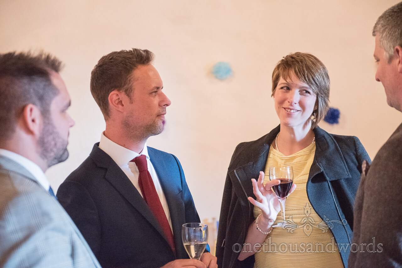 Guests enjoy a drink at reception from Walton Castle wedding photographs