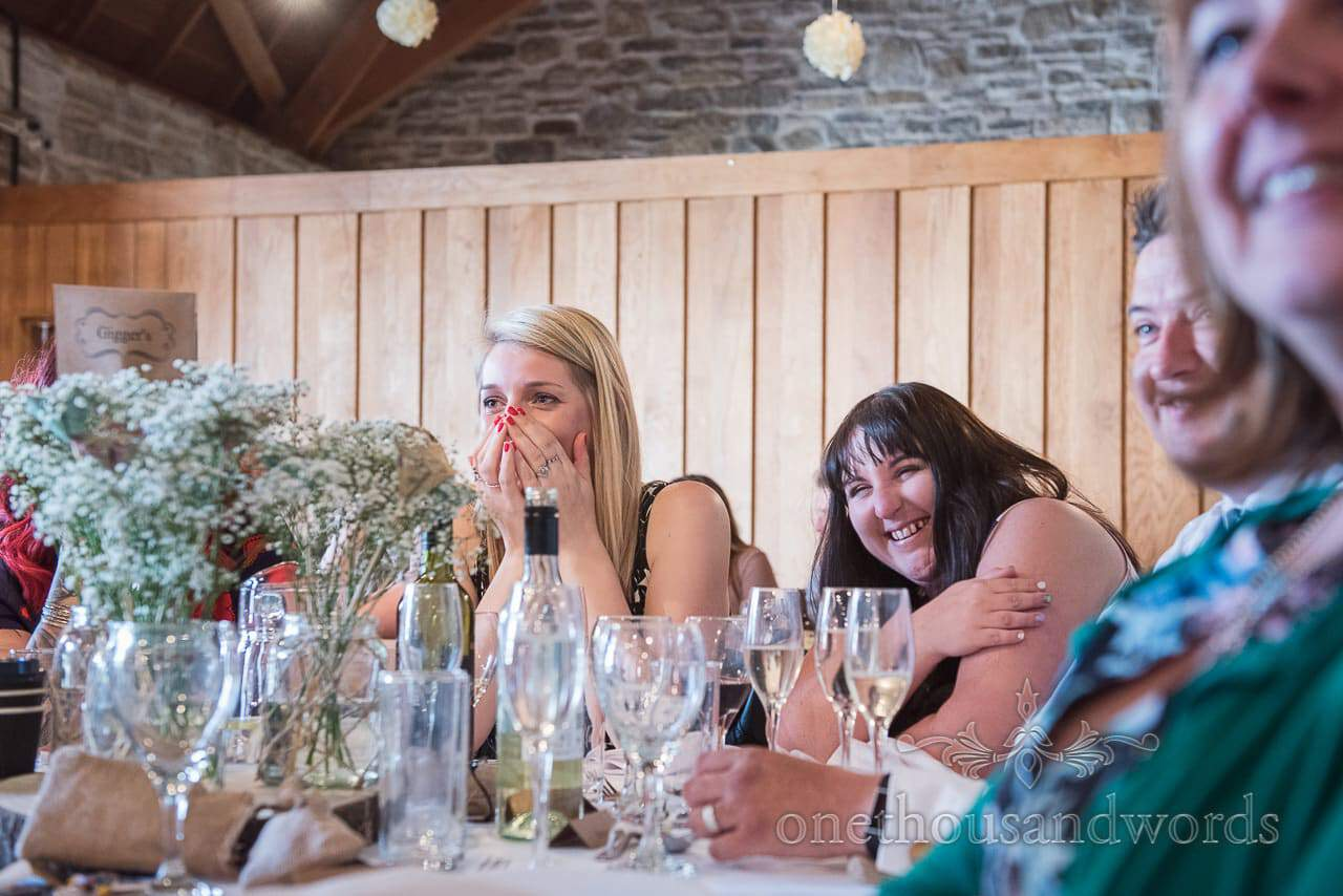 Guests react to speech at Scaplens court wedding photographs