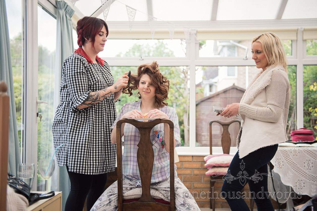 Hair styling on morning of Scaplens Court wedding photographs