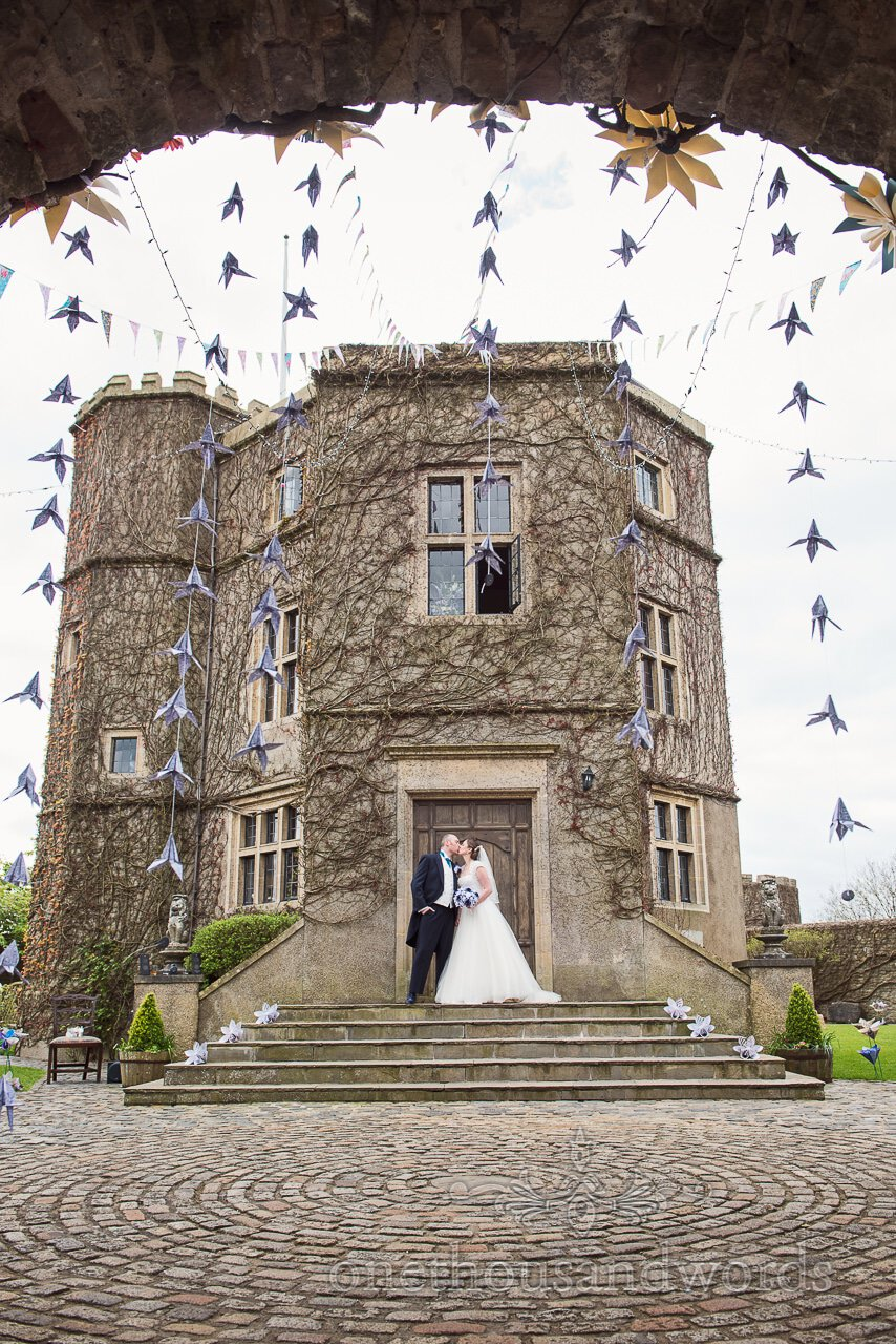 Kiss on the steps at Walton Castle wedding photographs