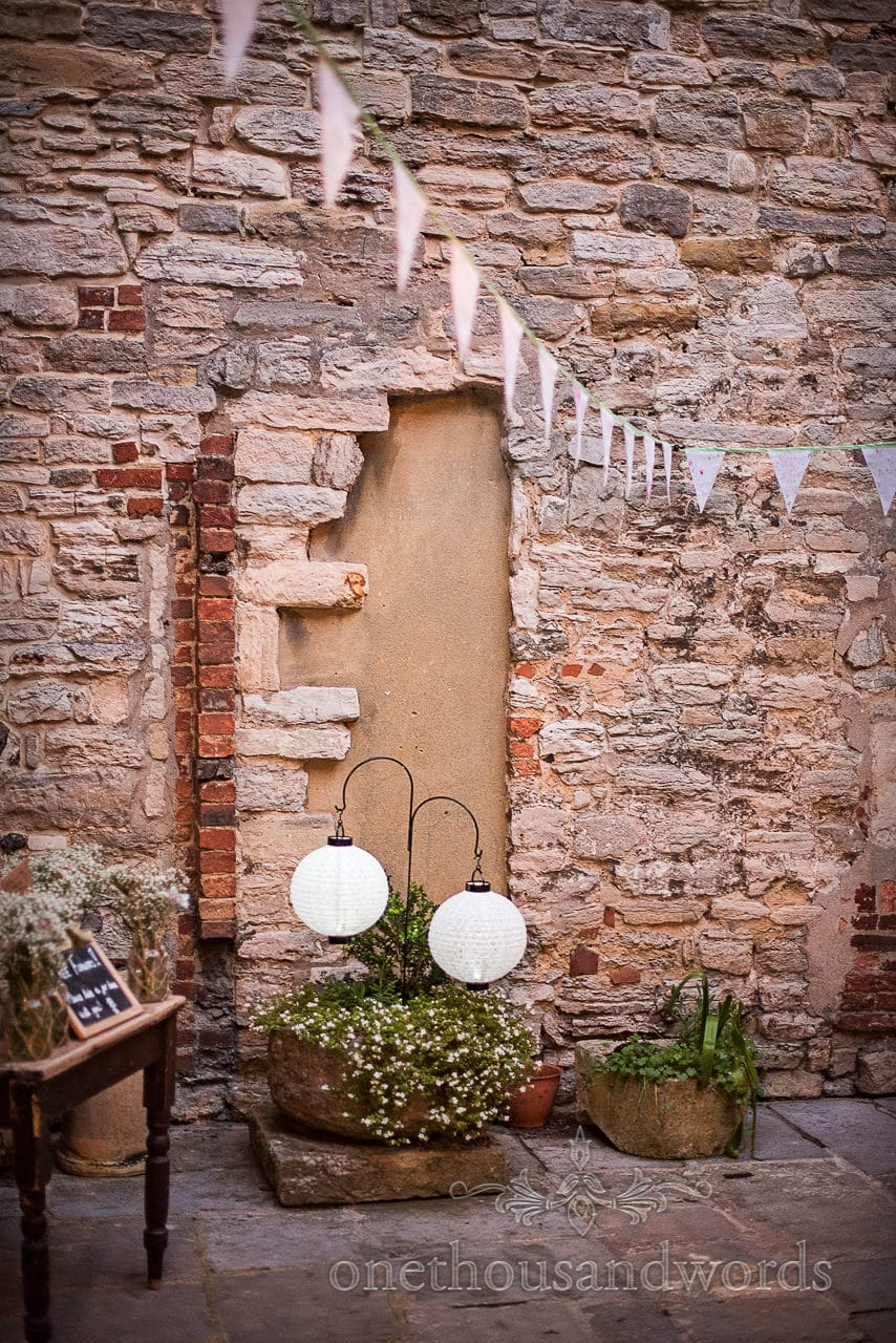 Lantern and bunting details at Scaplens court wedding photographs