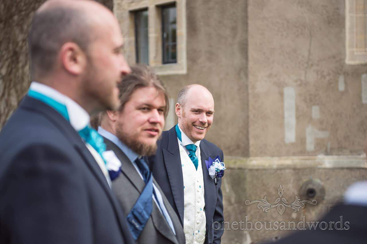 Laughing groom at Walton Castle wedding photographs