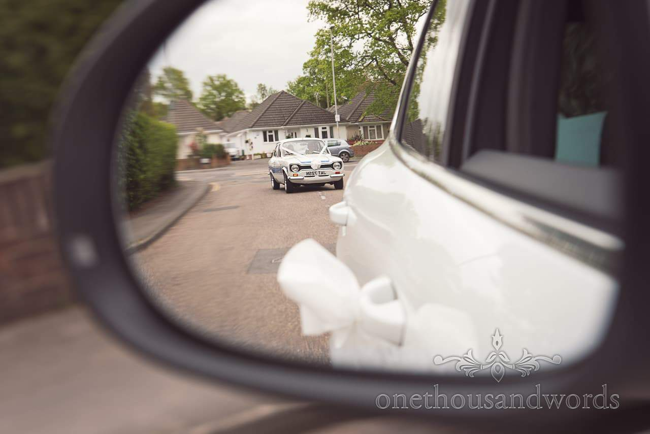 MKI Ford Escort wedding car in mirror at Scaplens Court wedding photographs