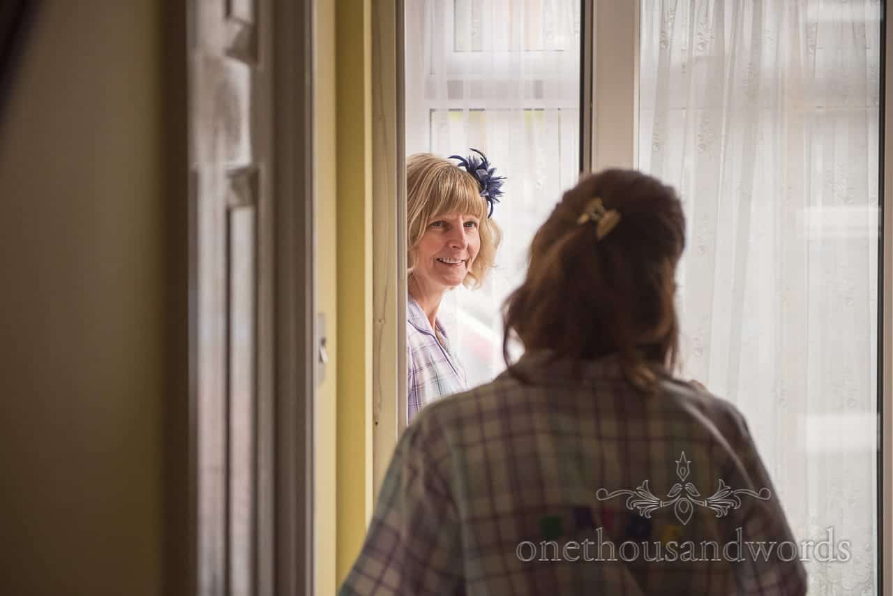 Mother of the bride on morning of Scaplens Court wedding photographs
