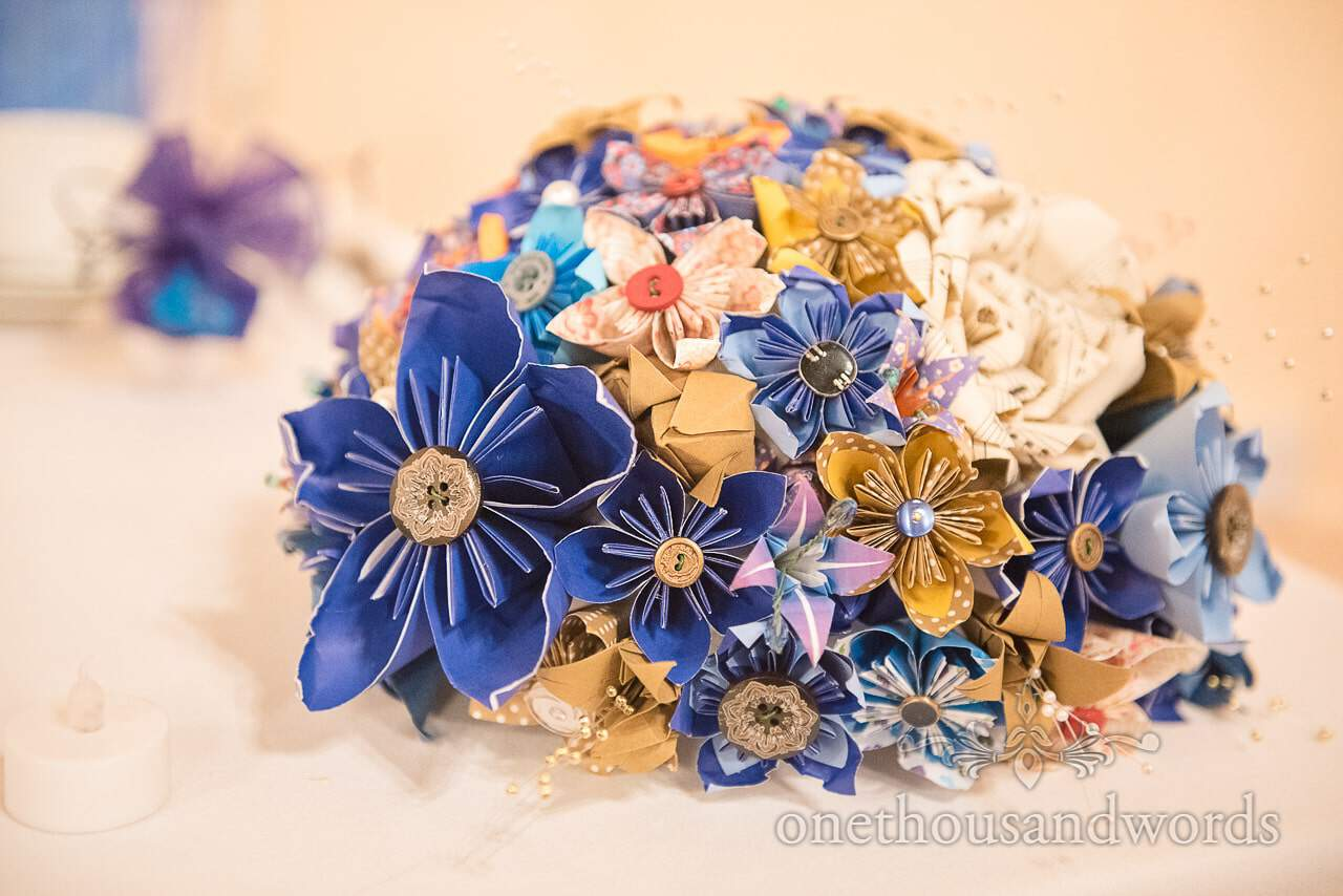 Multi coloured patterned paper and button wedding bouquet