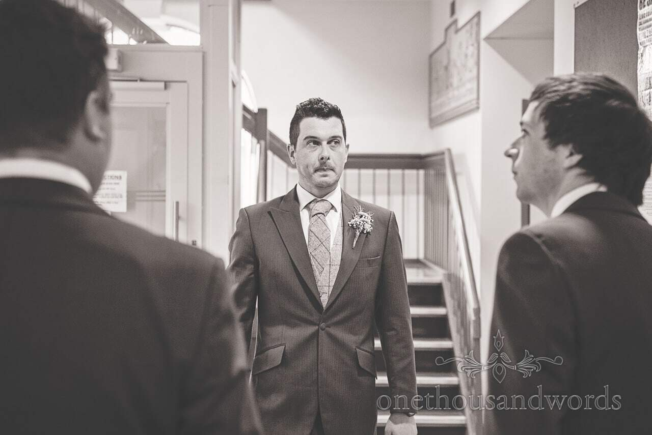 Nervous looking groom with groomsmen at Poole guildhall wedding photographs