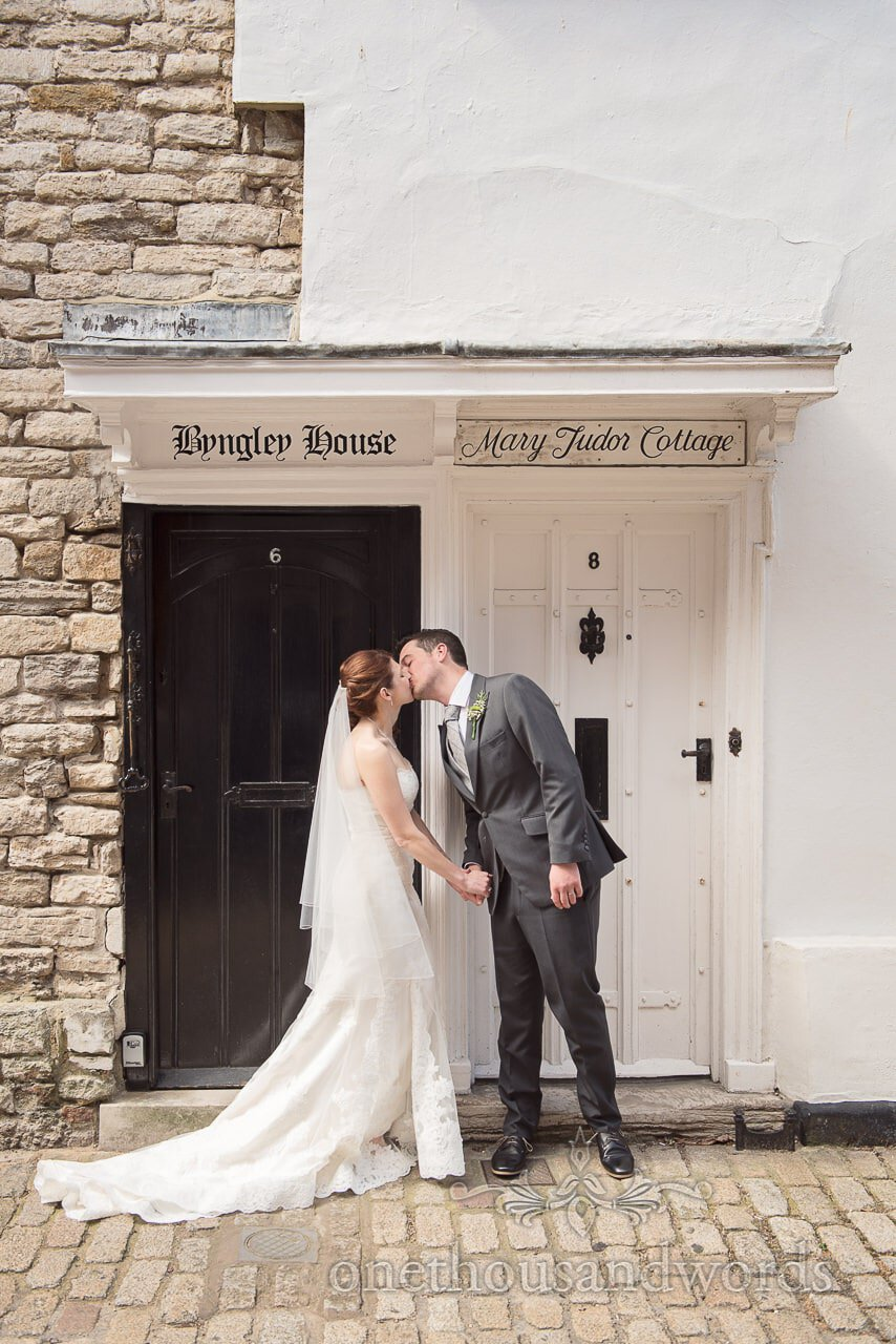 Newlyweds in doorway from Scaplens court wedding photographs