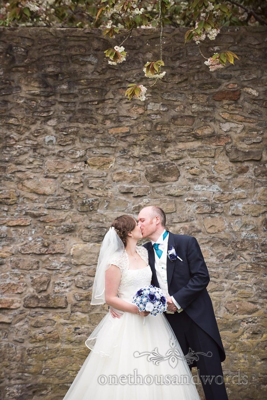 Newlyweds kiss at Walton Castle wedding photographs