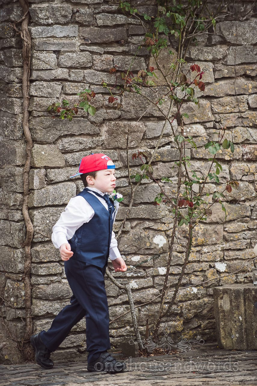 Page boy in Spiderman cap and blue wedding suit wedding
