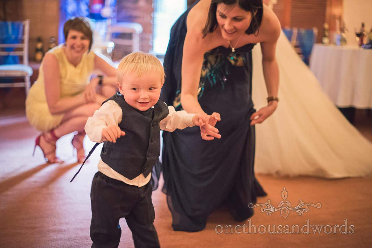 Page boy on the dance floor at Walton Castle wedding photographs