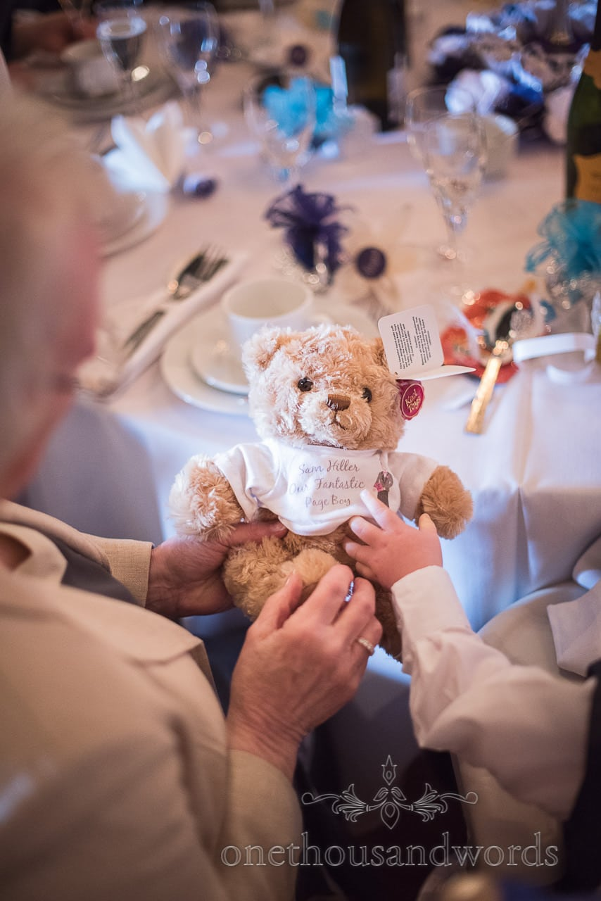 Page boy receives Teddy bear gift at Walton Castle wedding photographs
