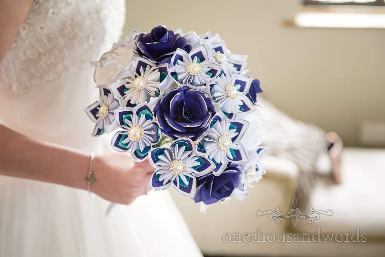 Paper and button bridal bouquet at Walton Castle wedding photographs