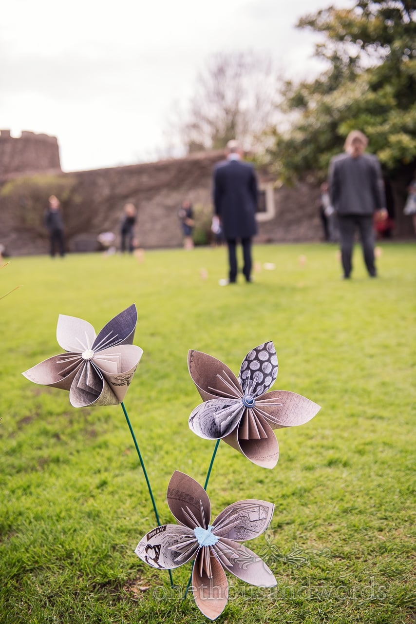 Paper and button flowers in garden at Walton Castle wedding photographs