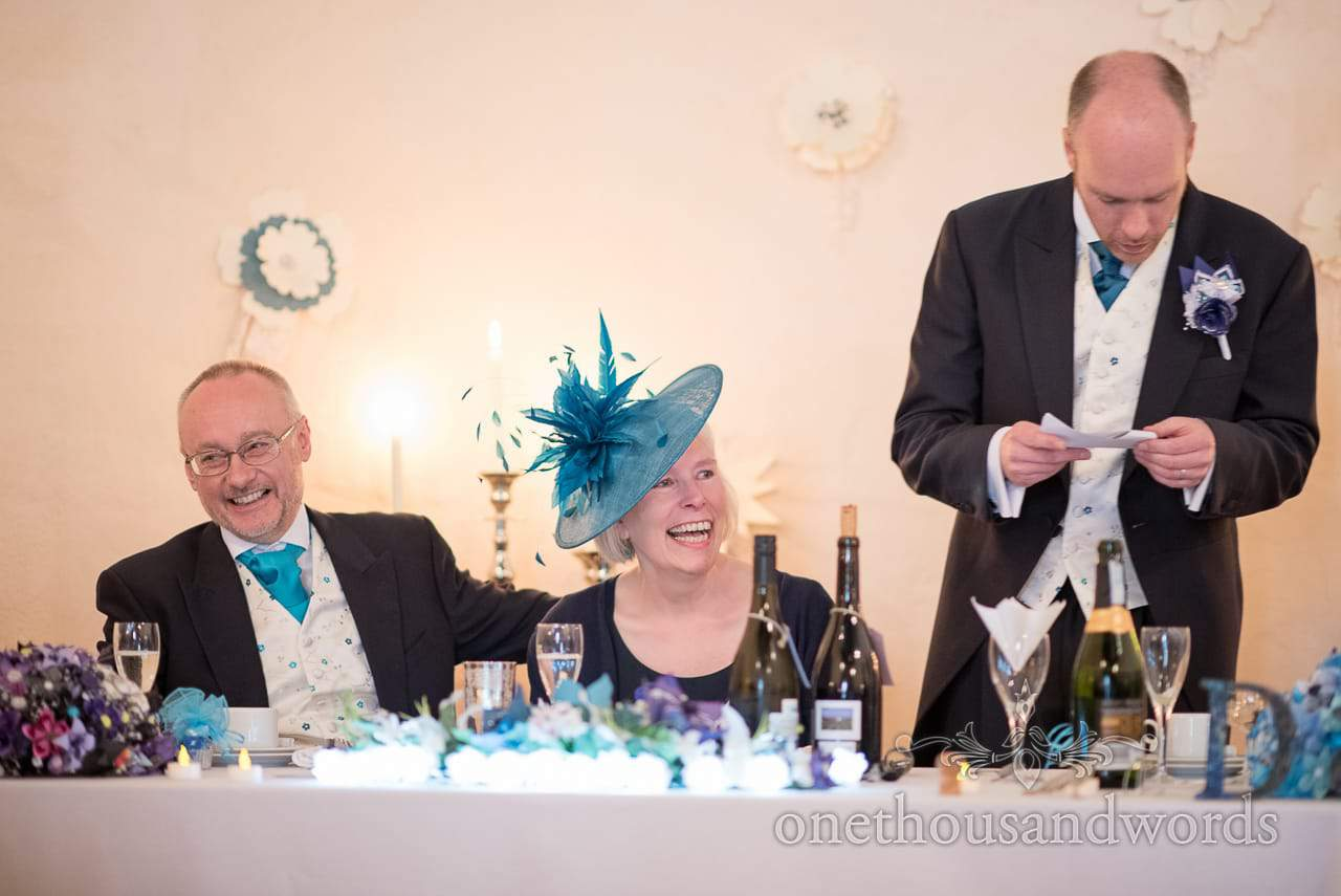 Parents reaction to grooms speech at Walton Castle wedding photographs