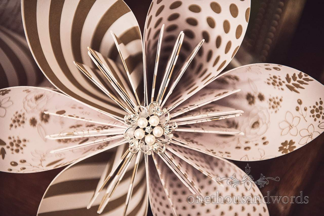 Patterned paper origami wedding flower with pearl and diamanté detailing