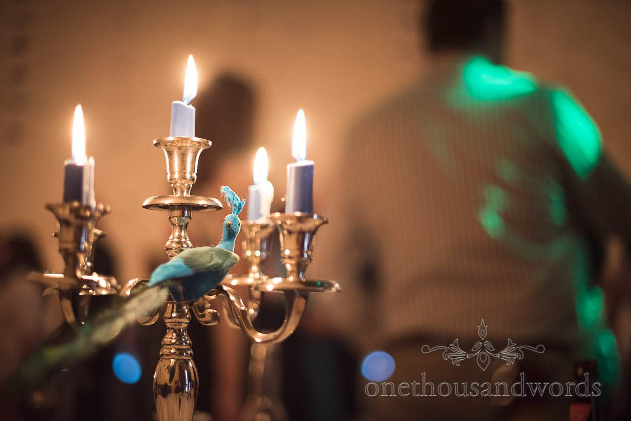 Peacock and candle details at Walton Castle wedding photographs