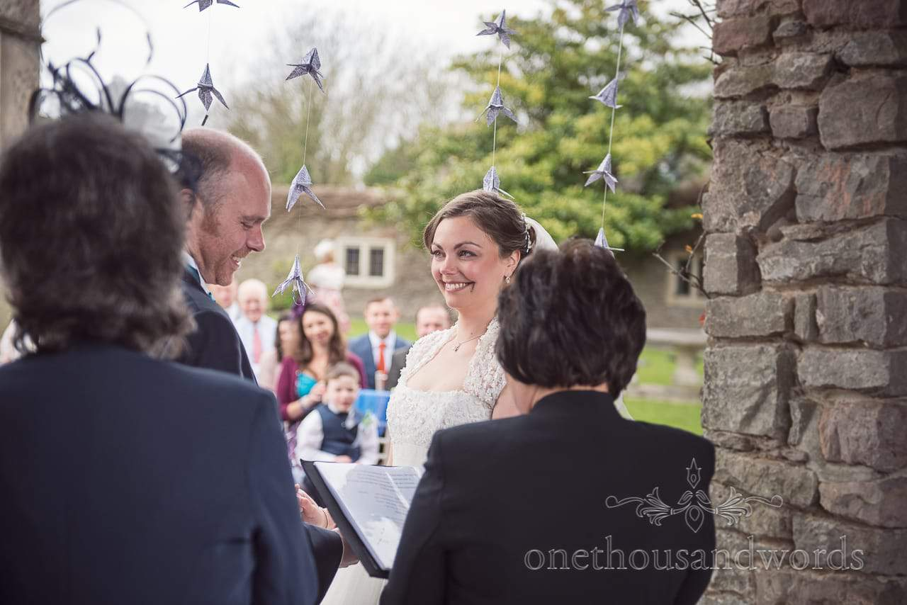 Smiling bride during ceremony at Walton Castle wedding photographs