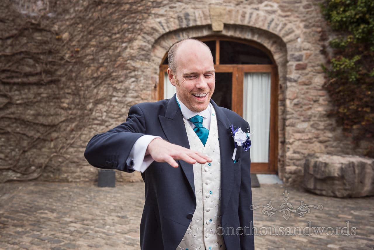 Steady hand groom before Walton Castle wedding photographs