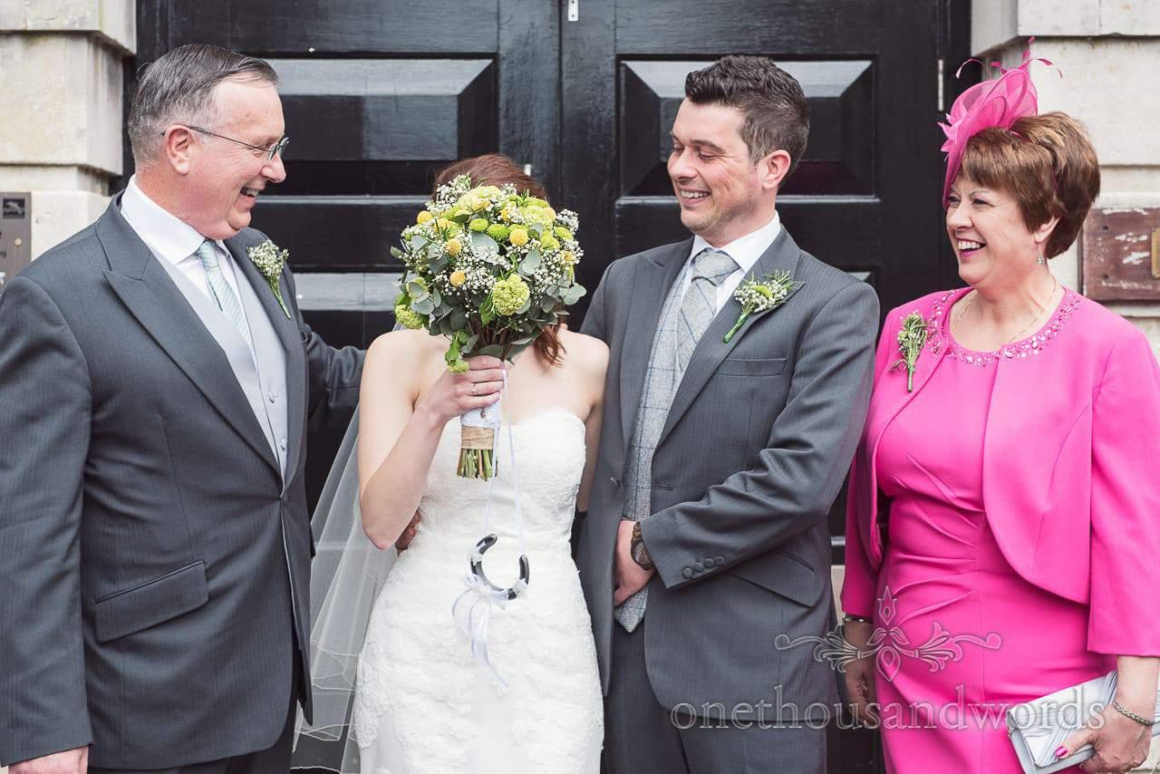 The bride hides at Scaplens Court wedding photographs