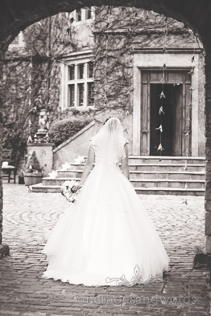 The bride waiting for her husband at Walton Castle wedding photographs
