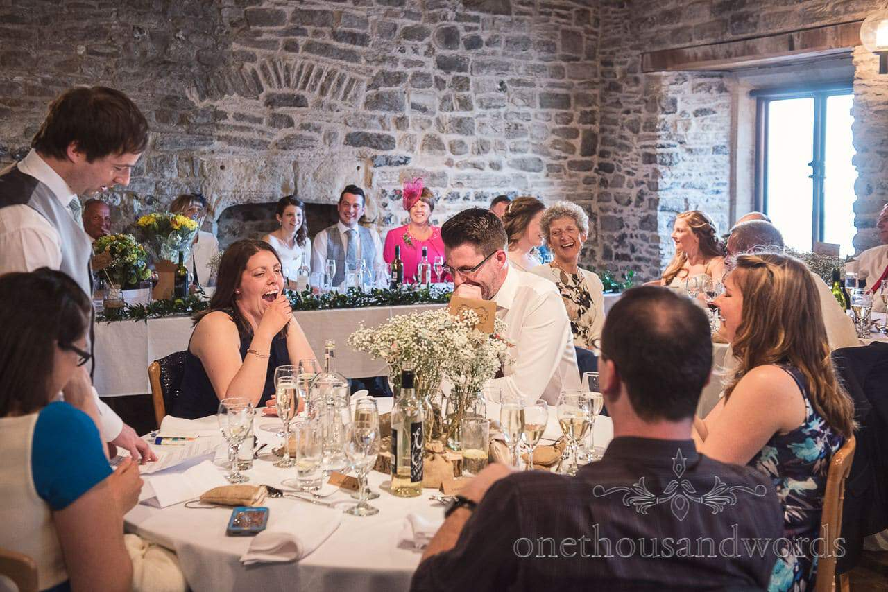 Top table react to best mans speech at Scaplens court wedding photographs