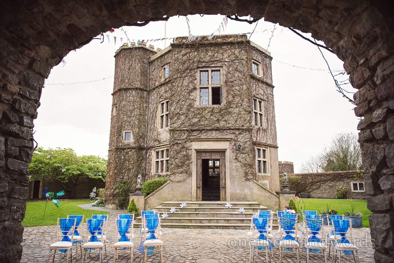 Walton Castle wedding photographs of outdoor wedding ceremony setup blue theme
